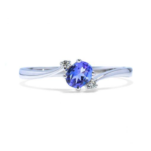 Zaujímavý zlatý prsteň s diamantmi a tanzanitom